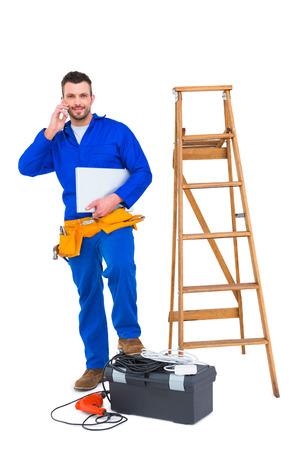 Carpenter on the phone on white background photo