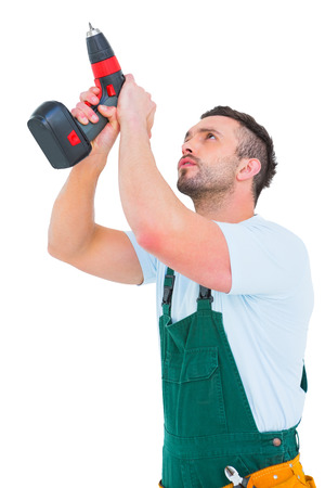 power drill: Handyman using power drill over white background Stock Photo
