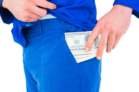 putting money in pocket: Handyman putting money in his pocket on white background