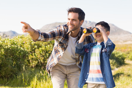 vacation  summer: Father and son on a hike together on a sunny day
