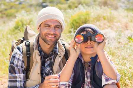 Father and son hiking in the mountains on a sunny day photo