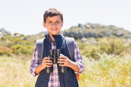 Little boy hiking in the mountains on a sunny day photo