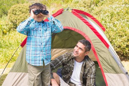 Father and son in their tent on a sunny day photo