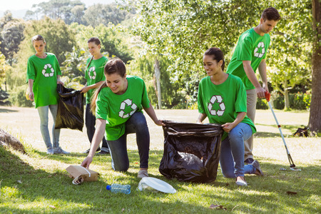 Environmental activists picking up trash on a sunny day Stock Photo