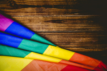 Gay pride flag on wooden table shot in studio Stockfoto
