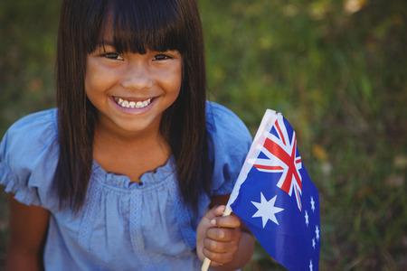 australia day: Cute little girl with australian flag on a sunny day Stock Photo