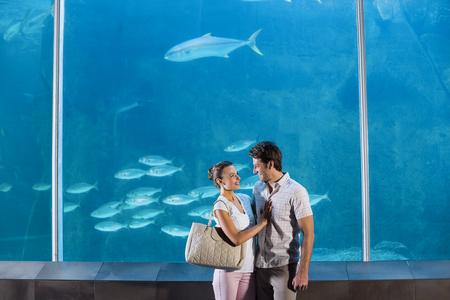 fishtank: Happy couple beside the fish tank at the aquarium