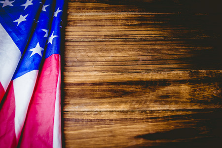 patriotic: American flag on wooden table shot in studio