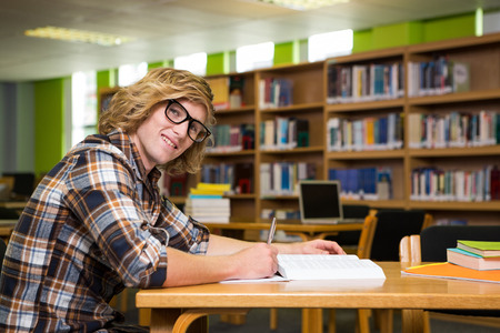 student studying: Student studying in the library at the university