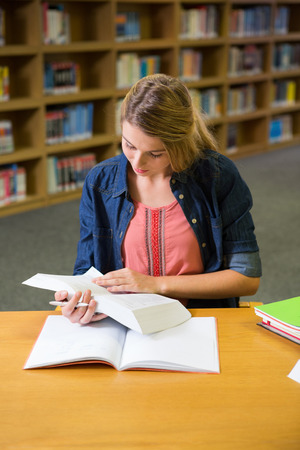 revising: Student studying in the library at the university