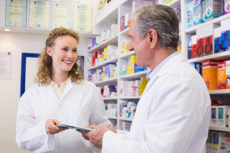 Team of pharmacist holding clipboard at hospital pharmacy  photo