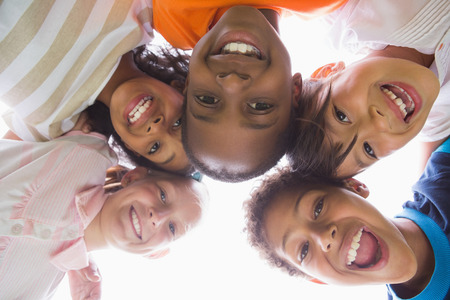 early childhood education: Pupils standing in a circle on a sunny day