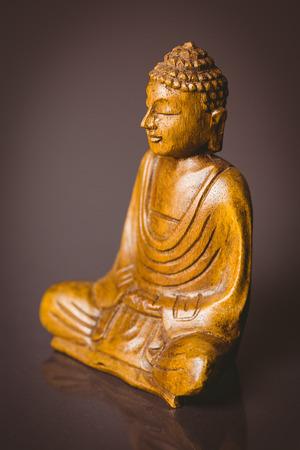 wood figurine: Wooden buddha statue shot in studio