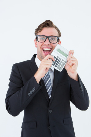 cheesy grin: Geeky businessman pointing to calculator on white background
