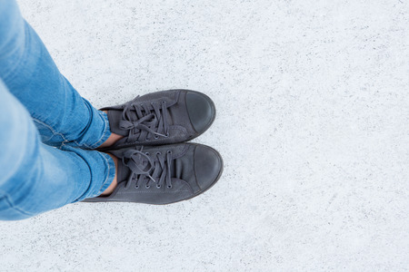 shoestring: Woman wearing trainers on white background