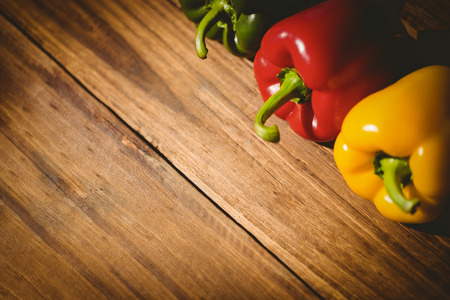 Three peppers on chopping board with copy space Stock Photo