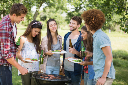 Hipsters have lunch and beers on a sunny day