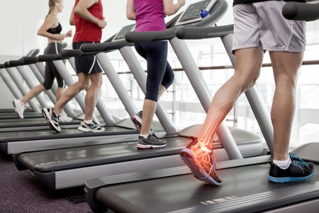 Digital composite of Highlighted ankle of man on treadmill photo
