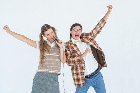 together with long tie: Happy geeky hipsters singing with microphone on white background