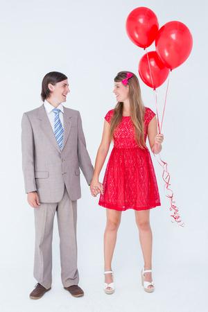 together with long tie: Sonriente pareja geek de pie de la mano sobre fondo blanco