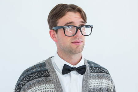 geeky: Thoughtful geeky hipster on white background