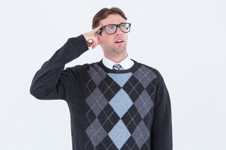 Geeky hipster thinking with finger on temple on white background photo