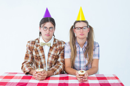 together with long tie: Unsmiling geeky hipsters celebrating birthday on white background