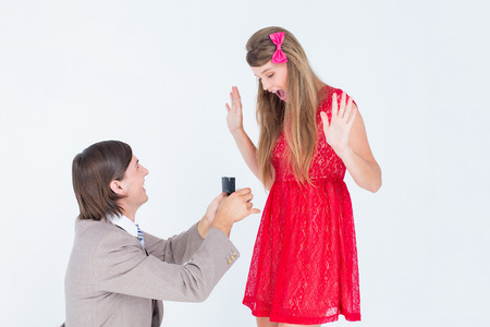 proposal of marriage: Hipster on bended knee doing a marriage proposal to his girlfriend on white background