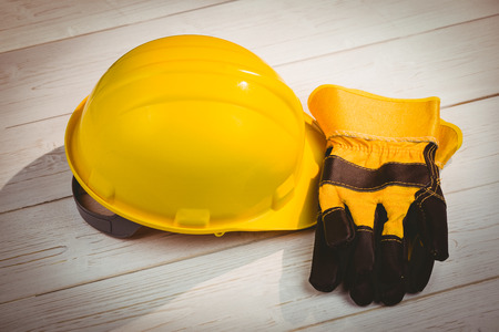 protective work wear: Hard hat and protective gloves shot in studio