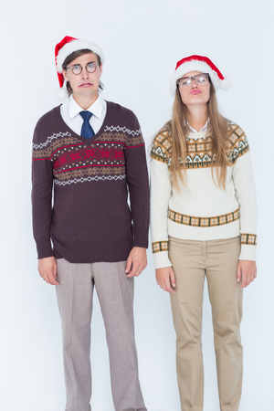 desolaci�n: Sad geeky hipster couple on white background