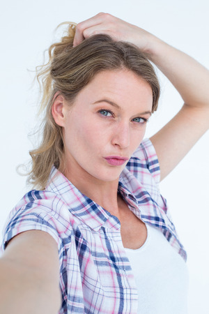 tied hair: Pretty hipster posing in front of the camera on white background Stock Photo