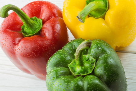 bellpepper: Three peppers on chopping board with copy space Stock Photo