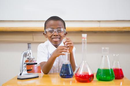 liquids: Cute pupil looking at liquids at elementary school