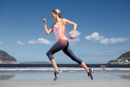 skeleton: Digital composite of Highlighted back bones of jogging woman on beach