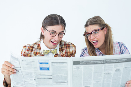 together with long tie: Geeky hipsters reading the newspaper on white background