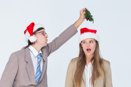 geeky: Geeky hipster with mistletoe on white background
