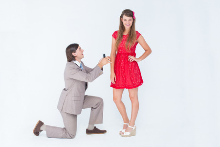 bended: Hipster on bended knee doing a marriage proposal to his girlfriend on white background