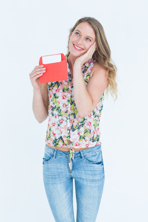 Smiling woman with letter on white background photo