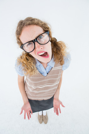 unclear: Confused geeky hipster woman on white background