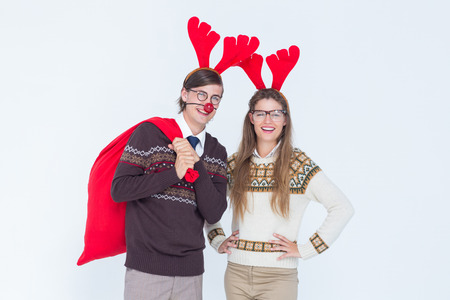 headband: Happy geeky hipster couple with stag headband on white background
