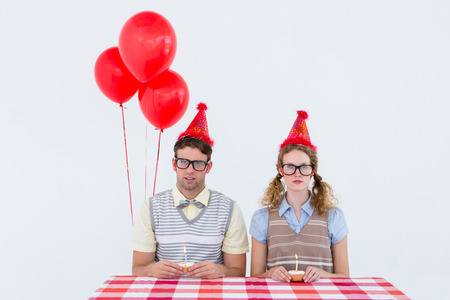 birthday cake: Geeky hipster couple celebrating his birthday on white background