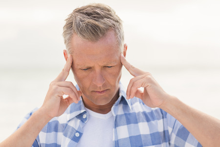 Casual man feeling worried at the beach Stock Photo