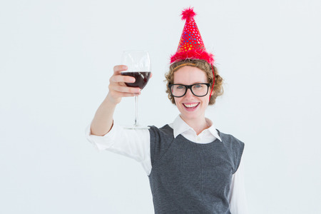 toasting: Happy geeky hipster toasting on white background Stock Photo