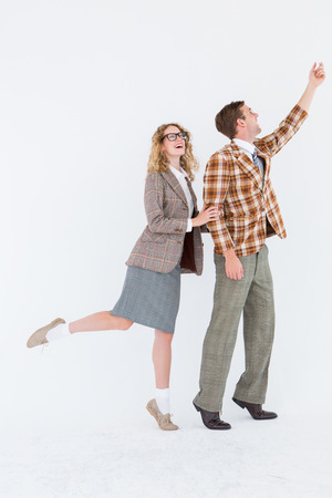 geeky: Happy geeky hipster couple on white background Stock Photo