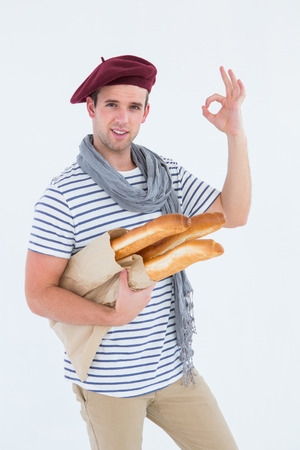 French guy with beret holding baguettes on white background Stock Photo
