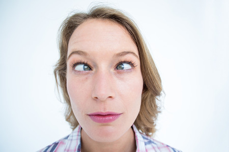 squint: Funny hipster grimacing on white background Stock Photo