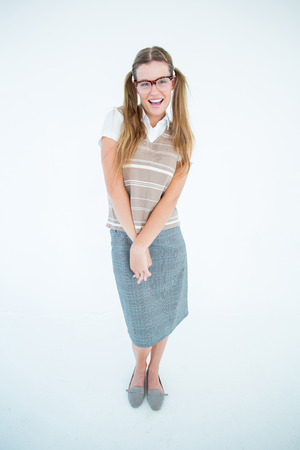 cheesy grin: Smiling geeky hipster smiling at camera on white background