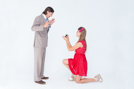 bended: Pretty hipster on bended knee doing a marriage proposal to her boyfriend on white background