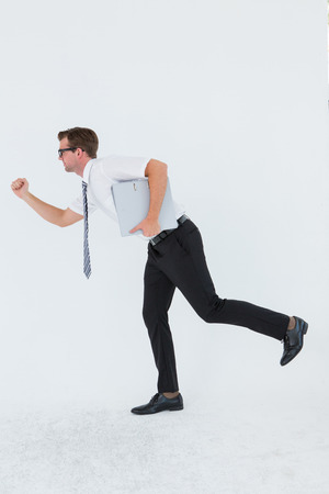 running late: Geeky businessman running late on white background