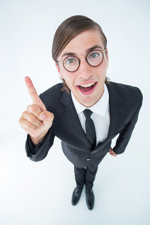 geeky: Geeky businessman pointing up on white background Stock Photo